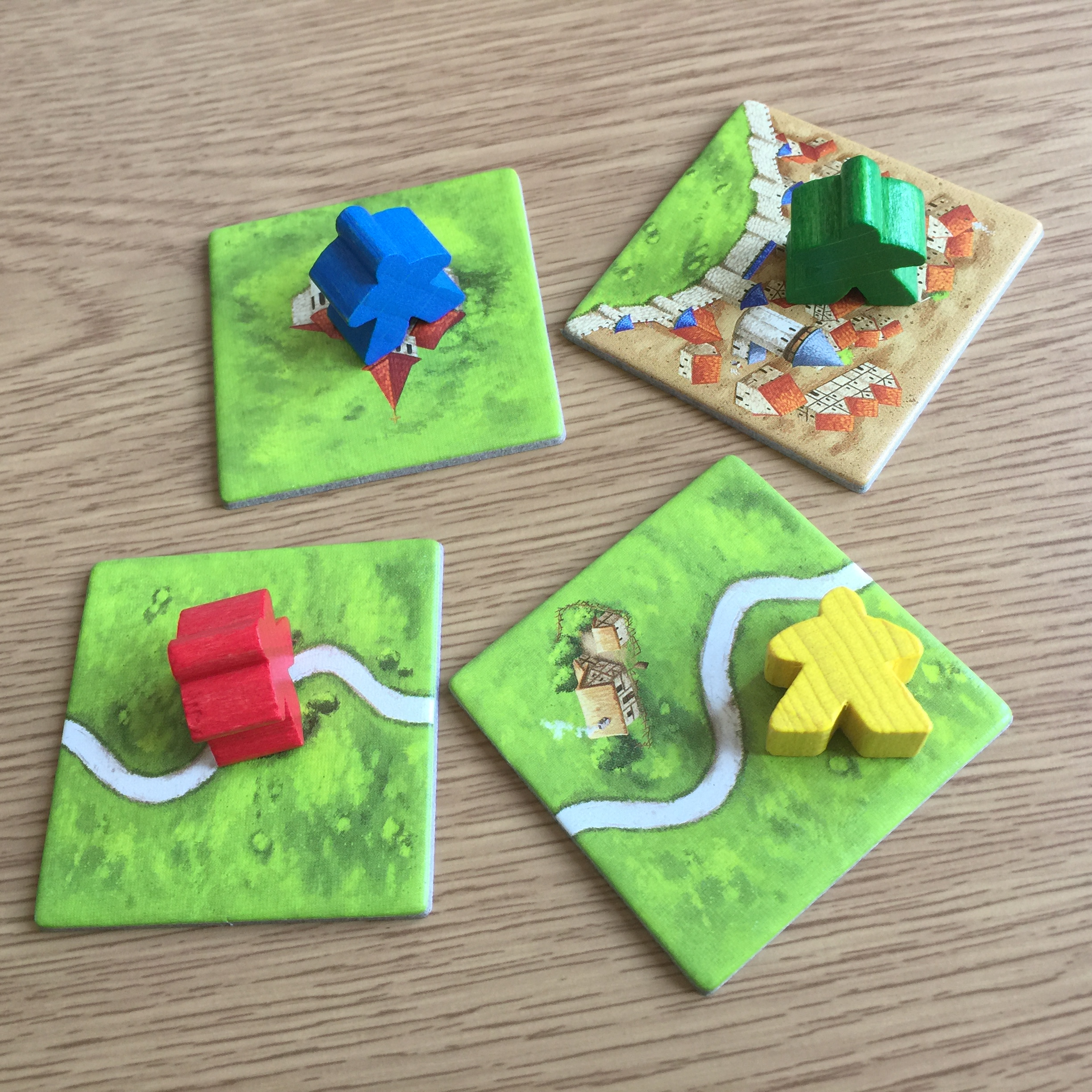 Carcassonne - Farmer (yellow), Highwayman (red), Knight (green), and Monk (blue)