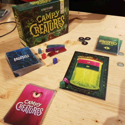 A photograph of Campy Creatures, showing the game box and the game components.