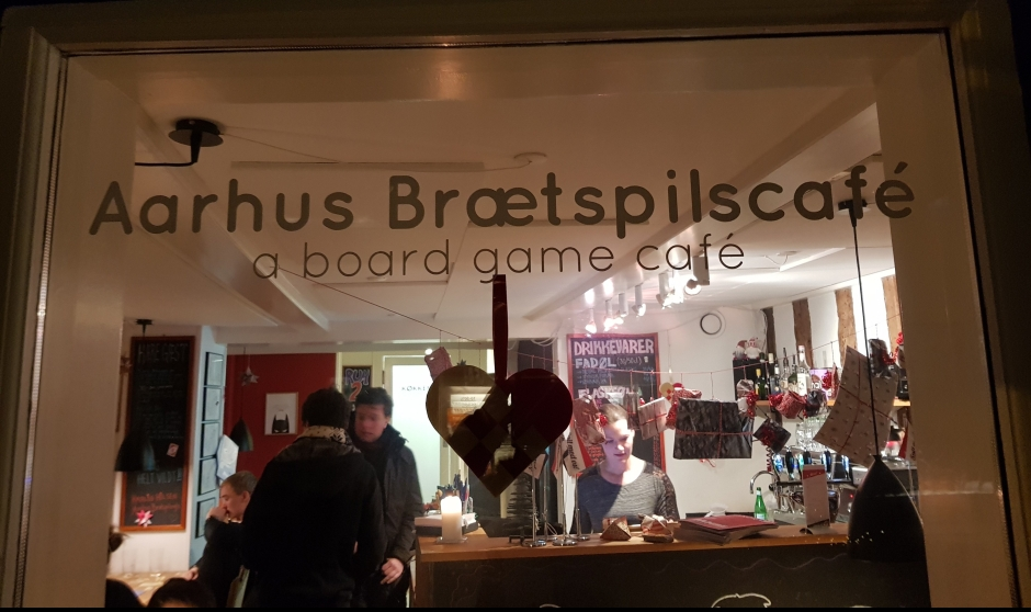 A view of the Aarhus Brætspilscafe taken by looking through the window.