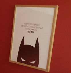 A photo of a picture on the wall of Aarhus Braetspilscafe. The picture has the words 'always be yourself unless you can be batman then always be batman.'