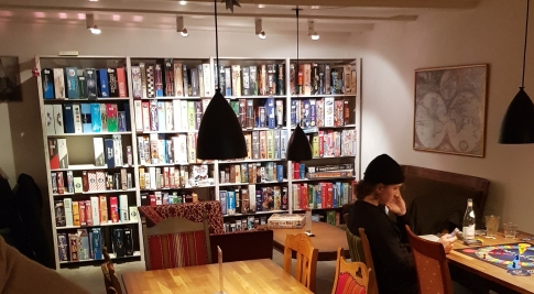 Photograph taken of the game selection on one set of shelves at Aarhus Braetspilscafe