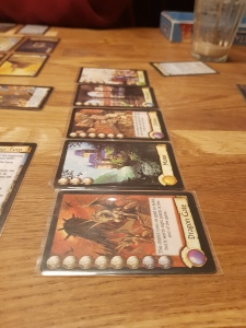 A mid-game photograph of citadels by Brun Faidutti - An awesome city containing a Dragon Gate and a Library!