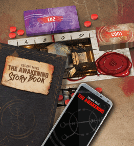 A photo showing the components for Escape Tales- The Awakening. The image shows two decks of cards, the game boards, story book and the phone app. (image credit Board and Dice)