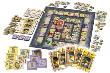 An image showing the game board and game components of Luxor. Theres lots of cards, meeples and tokens. The game board has tiles laid out in a pathway that spirals into the centre of the board. The centre is the Pharoahs tomb. (Image credit - Queen Games)