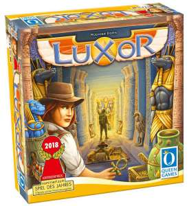 An image showing the Luxor box art. A female treasure hunter is stood in a temple corridor. The corridor is lined with columns and statues. Down the corridor there is another explorer facing the other way. (Image Credit - Luxor)