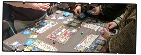 A photo from the UK Games Expo, showing a demo game of Heromaster: An Epic Game of Epic Fails in progress.