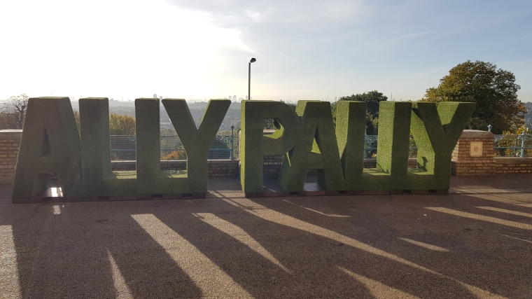 A picture showing a foliage sign spelling out Ally Pally. This was located outside the Alexander Palace on the day of Tabletop Gaming Live 2018.