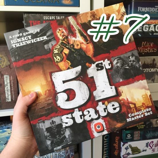 A photograph showing 51st State being held in front of shelves of other games.